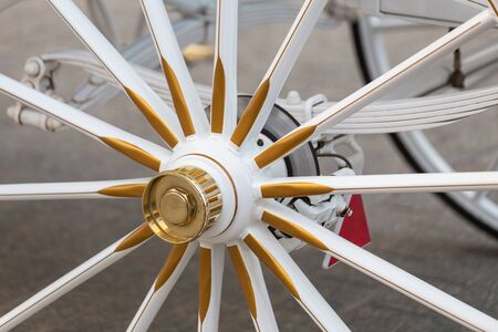 Wheel of horse-drawn carriage in close-up view. 스톡 콘텐츠