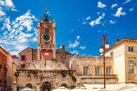 Clock tower on the People's Square in historic center of the Zadar town at the Mediterranean Sea, Croatia, Europe.