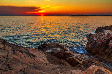 Sea landscape at sunset from Primosten town, a popular tourist destination on the Dalmatian coast of Adriatic sea in Croatia, Europe. Stock Photo