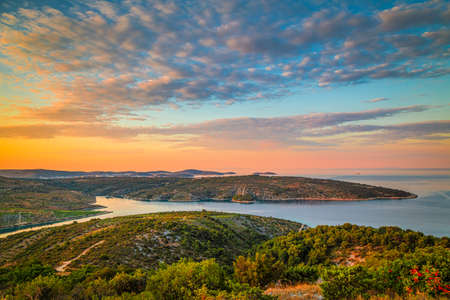 Panoramic view of Adriatic coast near The Primosten town at the colorful dawn of the day, Croatia, Europe.