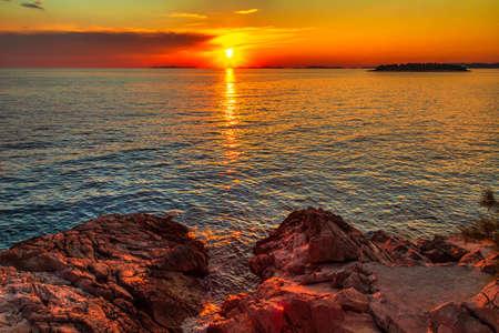 Sea landscape at sunset from Primosten town, a popular tourist destination on the Dalmatian coast of Adriatic sea in Croatia, Europe.
