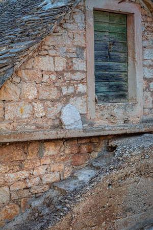 Old stone house in Primosten town, a popular tourist destination on the Dalmatian coast of Adriatic sea in Croatia, Europe.