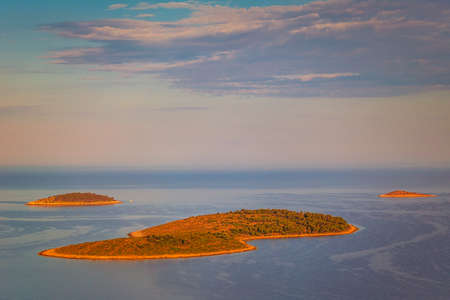 Panoramic view of Adriatic coast near The Primosten town at the colorful dawn of the day, Croatia, Europe. Stock Photo