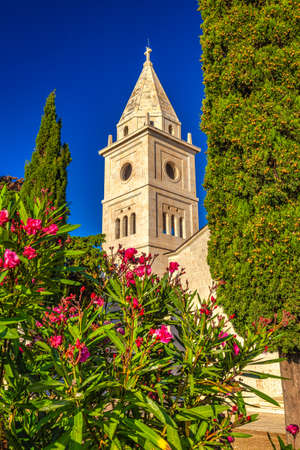 Bell tower of St George Church in Primosten town, a popular tourist destination on the Dalmatian coast of Adriatic sea in Croatia, Europe.