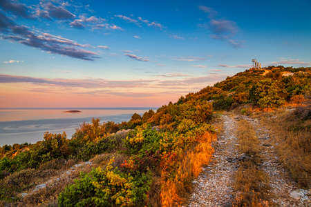 Hill with Our Lady Of Loreto Statue near The Primosten town at the colorful dawn of the day, Croatia, Europe.