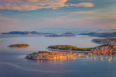 Panoramic view of Adriatic coast with The Primosten town at the colorful dawn of the day, Croatia, Europe. Stock Photo