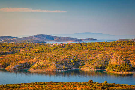 Sea landscape of Adriatic coast near The Primosten town at the colorful dawn of the day, Croatia, Europe.