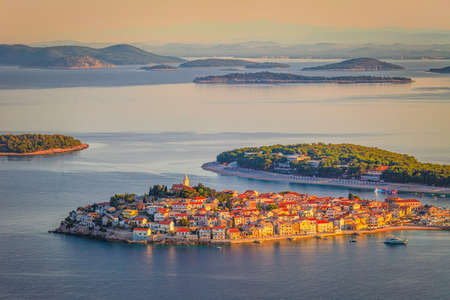Panoramic view of Adriatic coast with The Primosten town at the colorful dawn of the day, Croatia, Europe.