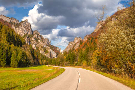 Road through a rocky gorge in a mountain valley at autumn. The Vratna valley in Mala Fatra national park, Slovakia, Europe.