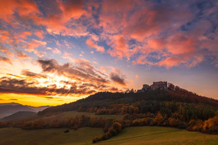 Fall landscape at sunset. The medieval castle Lietava and surrounding landscape nearby Zilina town, Slovakia, Europe.