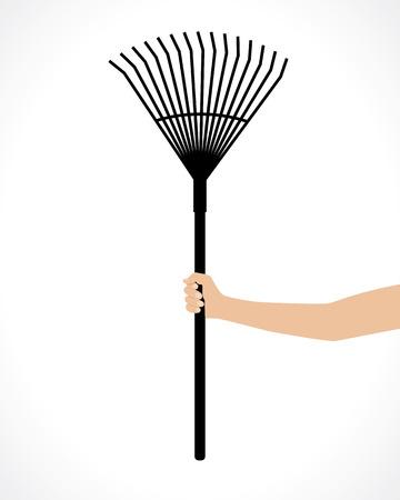raking: rake in hand for raking leaves