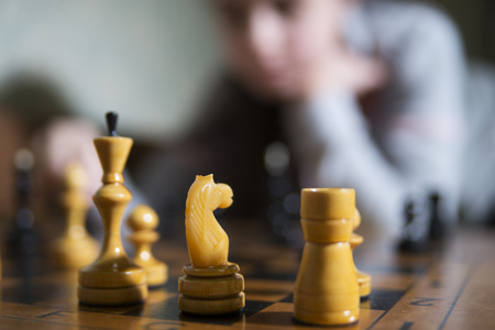 teen girl making checkmate playing chess, she is winner Stock Photo