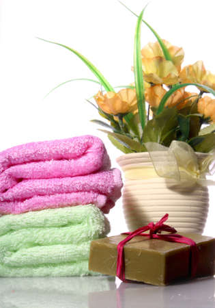 Handmade soap and a bouquet of yellow flowers in a pot photo