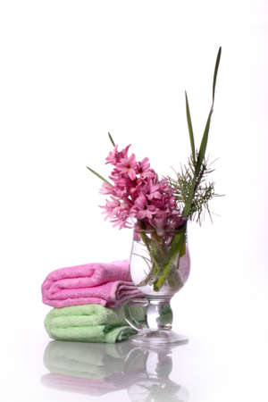 Two towels and a bouquet of hyacinth on a white background photo