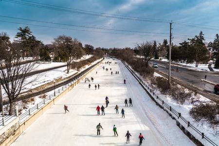 OTTAWA, ONTARIO  CANADA - JANUARY 20  2018: PEOPLE SKATING ON RIDEAU CANAL