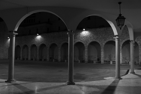 surrounds: Night view of a colonnade That surrounds a parvis in Umbria Stock Photo