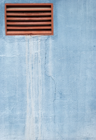 Blue wall with a ventilation window