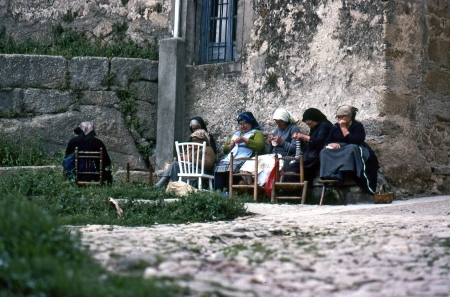 A group of women of the village sew together at the front of a stone house on June, 1980 in Miranda del Casta�ar, Salamanca, Spain
