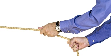 A businessman pulling a rope photo