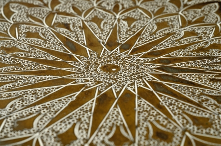 Close up of a old engraved brass tray photo