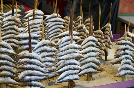 Freshly Caught Sardines cook on the spit at a Beachside outdoor Cafe in Spain Stock Photo - 15122983