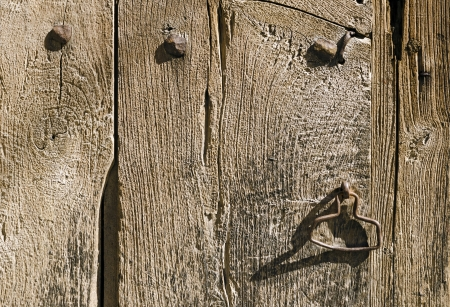 Close up of a handle on the old wooden door in an abandoned house photo