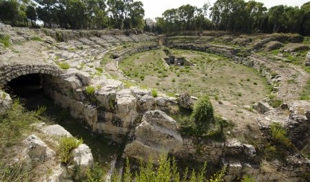 ruins of the Roman amphitheater in Syracuse Stock Photo