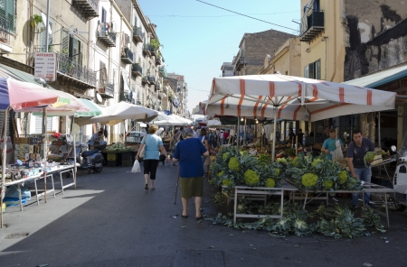 PALERMO, SICILY, ITALY - OCTOBER 3, 2012: Buyers and sellers in a street market of fruits and vegetables, on October 3, 2012 in Palermo, Italy