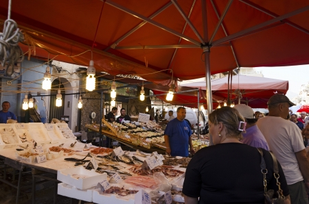 PALERMO, SICILY, ITALY - OCTOBER 3, 2012: An unidentified middle-aged man sells fish at a street stall, on October 3, 2012 in Palermo, Italy