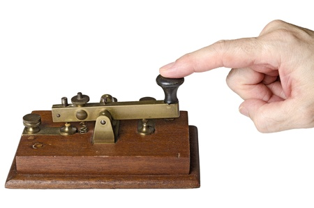 hand sending a telegraph message, isolated on white background photo