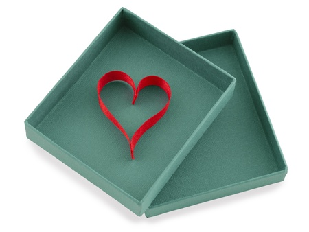 Red ribbon in heart shape in an open box Stock Photo - 16875736