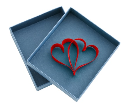 Two red ribbon in heart shape in an open box Stock Photo - 16875735