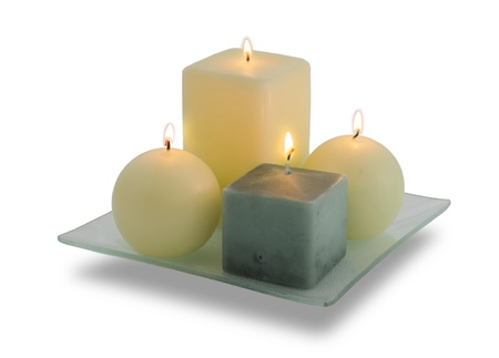 A set of four Christmas candles burning on a white background  Very clean image