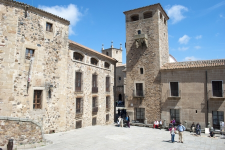 CACERES, SPAIN - APRIL 23: Tourists at the Cathedral Square. April 23, 2010 in Caceres, Spain. Caceres downtown is a magnificent example of medieval architecture