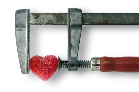 heart healing concept - red heart in the vice tool photo