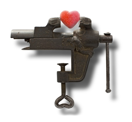 heart under pressure with old vise grip on white background Stock Photo - 17459490