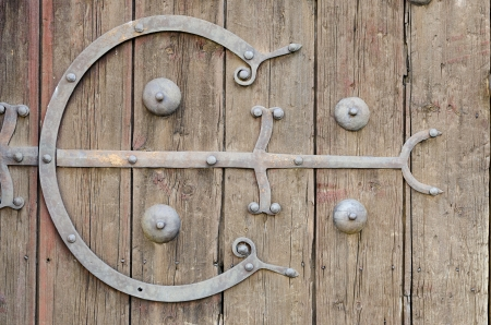 Metal ornaments on an old wooden door of a mansion in Castile, Spain photo