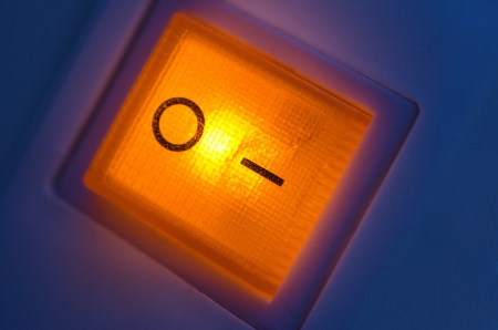 Toggle switch. orange illuminated photo
