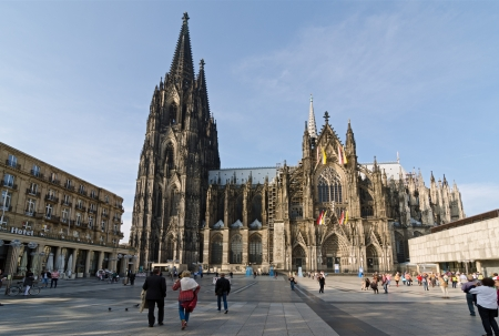 COLOGNE, GERMANY - SEPTEMBER 24: garden outside the Cologne Cathedral on September 24, 2013 in Cologne, Germany. commenced in 1248 and complete finished in 1880