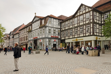 HAMELN, GERMANY - SEPTEMBER 25: people in a downtown shopping street in September 25, 2013 in Hameln, Germany. Hameln is known for the story of the Pied Piper of