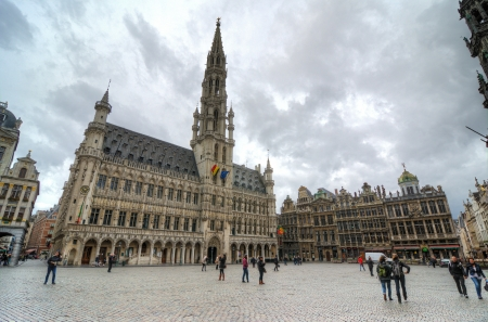 BRUSSELS, BELGIUM - OCTOBER 27 : Houses of the famous Grand Place on October 27, 2013, Brussels, Belgium. Grand Place was named by UNESCO as a World Heritage Site in 1998. Editorial