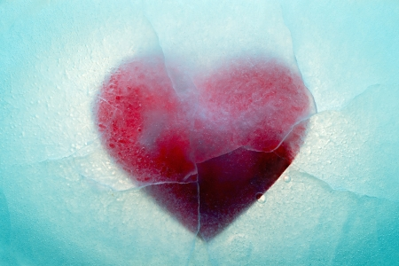 Red heart frozen in ice