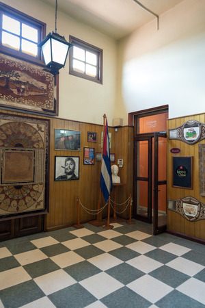 HAVANA, CUBA - MAY 5, 2014: Interior of a sales shop rum and snuff. The images of Ernesto Che Guevara, Fidel Castro and Jose Marti, are ubiquitous in Cuba