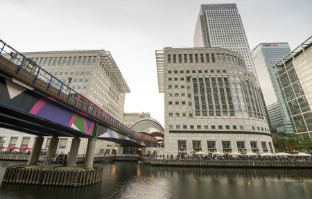 Canary Wharf is built on the site of the West India docks in the east of London. It has developed into a thriving shopping and commercial district since the closure of the last commercial docks in 1980. Many major banks and services industries are tenants Stock Photo - 29556714