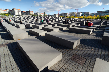 adolf hitler: BERLIN, GERMANY - SEPTEMBER 29, 2013: The Memorial to the Murdered Jews of Europe also known as the holocaust memorial. Designed by Peter Eisenman and Buro Happold, it consists of 4.7 acre site covered with 2,711 concrete slabs arranged in a grid formatio