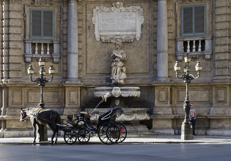 urbanism: PALERMO, SICILY, ITALY - OCTOBER 3, 2012: Carriage in Baroque square of Quattre Canti on October 3, 2012 in Palermo, Italy