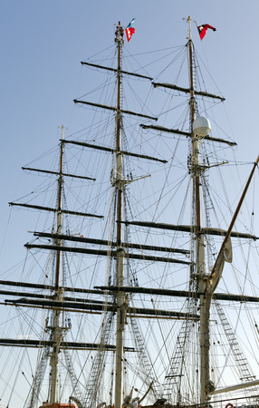 furled: SYRACUSA, ITALY - SEPTEMBER 29, 2012: three-masted sailing ship with sails furled on September 29, 2012 docked in the harbor of Syracuse, Italy