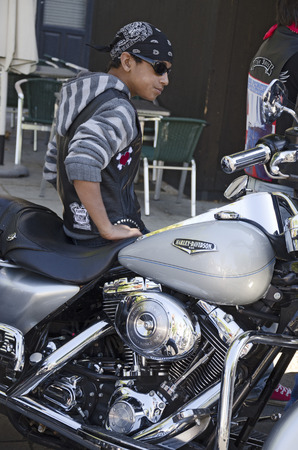 harley davidson motorcycle: A young man sitting on His Harley Davidson motorcycle During concentration at the celebration of the fair and festivities of the Virgin of St. Lawrence Virgen de San Lorenzo on September 2, 2012 in Valladolid, Spain