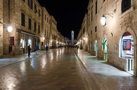 walking zone: DUBROVNIK, CROATIA - MAY 16, 2013: People walking down the main street in the old town of Dubrovnik at night. Pedestrian zone in an old, European town. On 16 May 2013 in Dubrovnik, Croatia