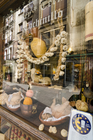 segovia: SEGOVIA, SPAIN - MARCH 3, 2013: window of a restaurant in Segovia. With the nearby Madrid, Segovia is a popular destination for small-scale tourism.